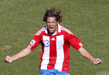 Paraguay's Enrique Vera celebrates after scoring a goal during their 2010 World Cup Group F soccer match against Slovakia