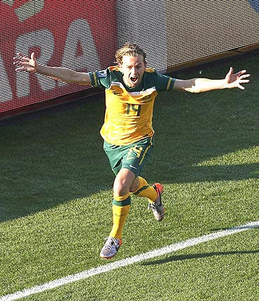 Australia's Brett Holman celebrates after scoring against Ghana