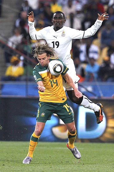 Australia's Brett Holman and Ghana's Lee Addy vie for possession
