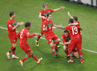 Portugal's Hugo Almeida celebrates his goal with team mates during the 2010 World Cup Group G match against North Korea
