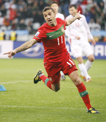 -Portugal's Simao Sabrosa celebrates his goal during the 2010 World Cup Group G soccer match against North Korea