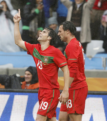 Portugal's Tiago celebrates his goal next to team mate Almeida during the 2010 World Cup Group G soccer match