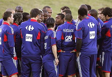 French players listen to their captain Patrice Evra (centre) before deciding not to take part in a training session