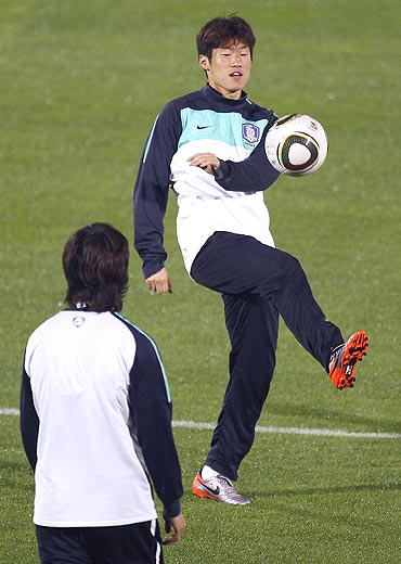 South Korea's Park Ji-sung (right) trains with a teammate during a practice session