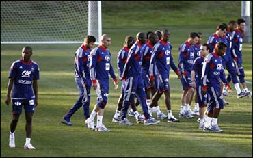 French players leave the field after refusing to take part in a training session on Sunday