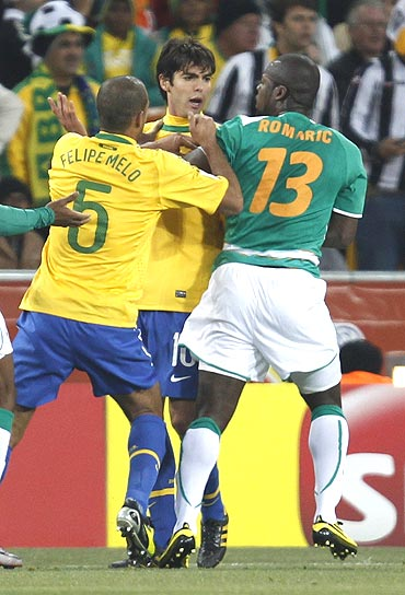 Brazil's Kaka (centre) argues with Ivory Coast's Romaric (right) as Felipe Melo tries to seperate the two
