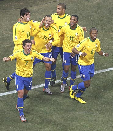 Brazil's Elano (7) celebrates with teammates after scoring