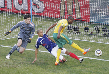 South Africa's Katlego Mphela (R) scores a goal past France's Gael Clichy (centre) and goalkeeper Hugo Lloris