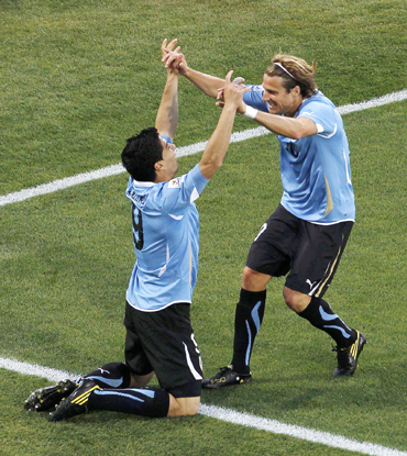 Uruguay's Luis Suarez celebrates with team mate Diego Forlan after scoring against Mexico