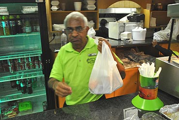 A shopkeeper hand me my Bunny Chow