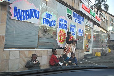 Poor folk at a street corner in Durban