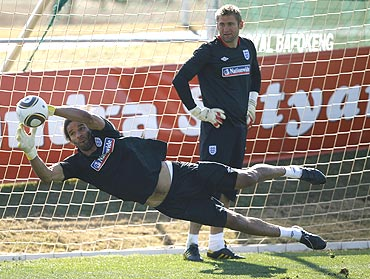 England keeper Robert Green (right) watches fellow goalkeeper David James make a save during a training session