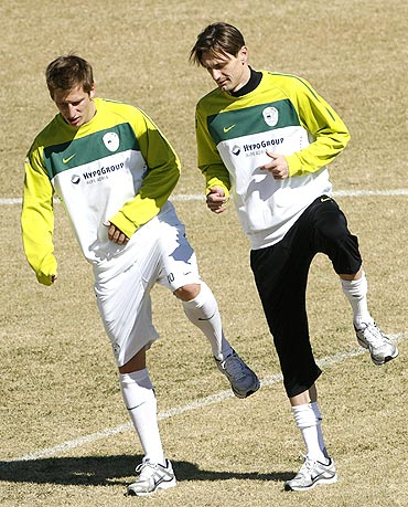 Slovenia's Valter Birsa (left) and Milivoje Novakovic go through the paces at a training session