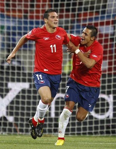 Chile's Mark Gonzalez celebrates after scoring against Switzerland