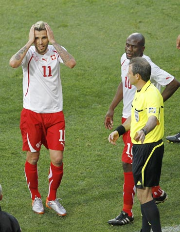 Switzerland's Behrami reacts after receiving a red card