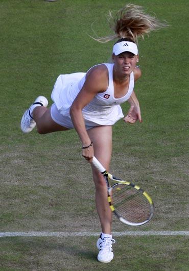 Caroline Wozniacki serves to Tathiana Garbin