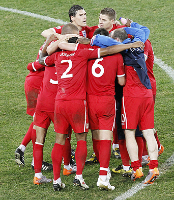 England team huddles after the 2010 World Cup Group C soccer match between Slovenia and England in Port Elizabeth