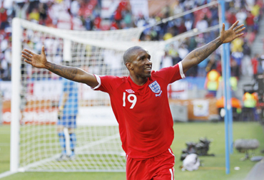 England's Jermain Defoe celebrates after scoring the first goal past Slovenia's goalkeeper Samir Handanovic