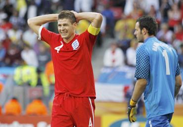 England's Steven Gerrard reacts next to Slovenia's Handanovic during 2010 World Cup Group C soccer match in Port Elizabeth
