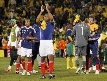 Thierry Henry leaves the field after losi