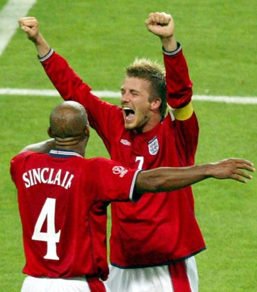 David Beckham celebrates after England beat Argentina