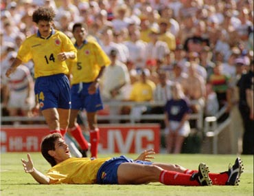 Andres Escobar reacts after scoring an own goal