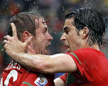 Portugal's Raul Meireles (left) celebrates with team mate Tiago after scoring a goal