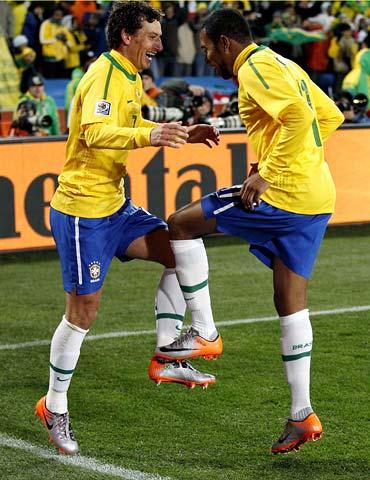 Brazil's Elano (left) celebrates his goal with team mate Robinho