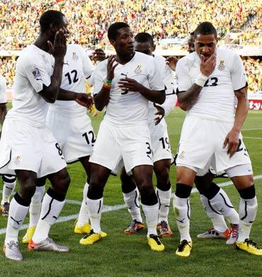 Ghana's Asamoah Gyan (No. 3) celebrates his goal with team mates