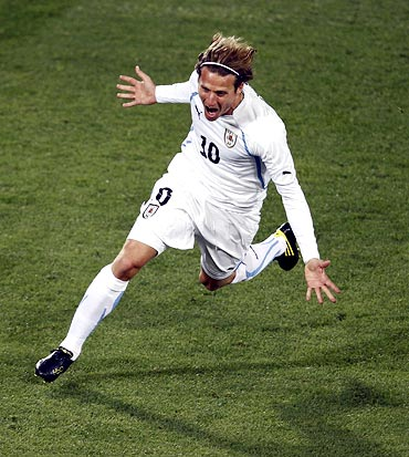 Uruguay's Diego Forlan celebrates his goal against South Africa