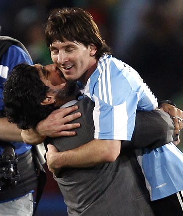 Argentina's Lionel Messi gets a peck on the cheek from coach Diego Maradona