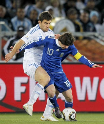 Argentina's Lionel Messi and Greece's Giorgos Karago