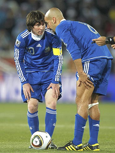 Lionel Messi (left) chats with Juan Sebastian Veron during the match