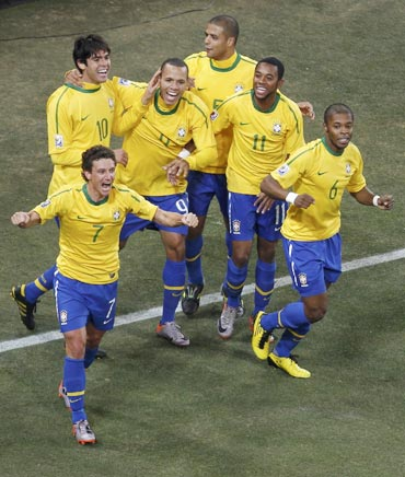 Brazilian players celebrate after a goal