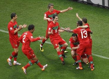 Portuguese celebrate after a goal
