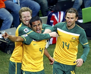 Tim Cahill (centre) celebrates after putting Australia ahead