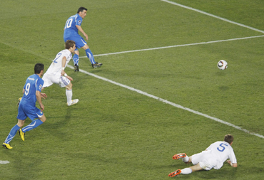Italy's Antonio Di Natale shoots to score their first goal during their 2010 World Cup Group F soccer match