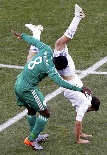 Nigerian Yakubu Aiyegbeni (left) clashes with Greece's Socratis Papastathopoulos