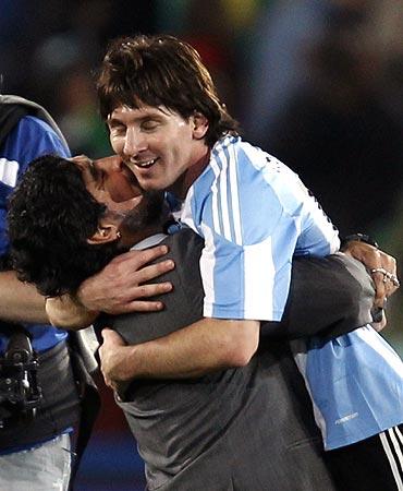Diego Maradona hugs Lionel Messi