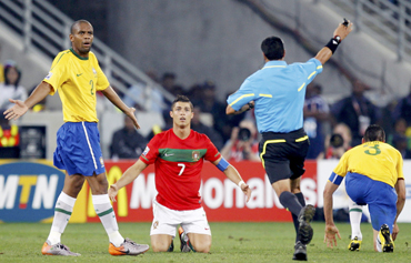 Brazil's Maicon (L) and Portugal's Cristiano Ronaldo (C) react to referee Benito Archindia of Mexico