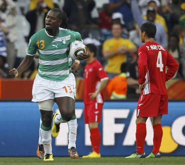 Ivory Coast's Ndri Romaric  celebrates during the 2010 World Cup Group G soccer match at Mbombela stadium in Nelspruit