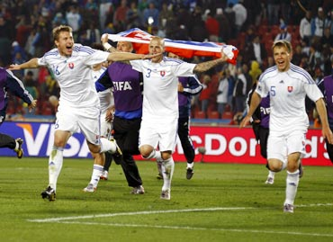 Slovakia's players celebrate their victory against Italy