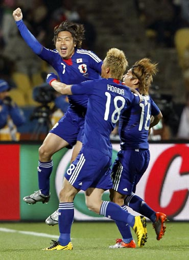 Keisuke Honda (left) celebrates his goal with team mates