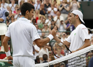 Serbia's Novak Djokovic shakes hands with Spain's Albert Montanes