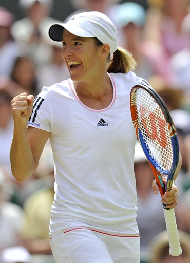 Justine Henin celebrates defeating Petrova