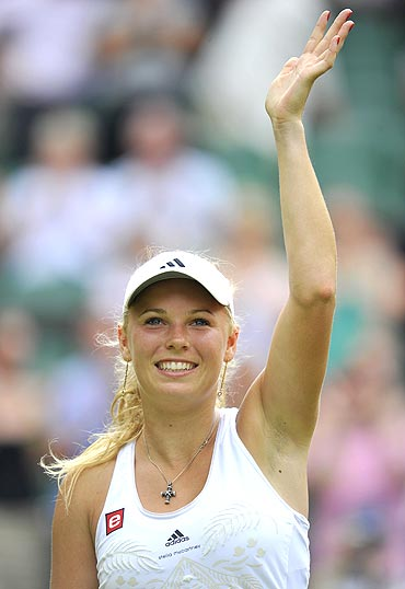 Caroline Wozniacki celebrates after winning against Anastasia Pavlyuchenkova