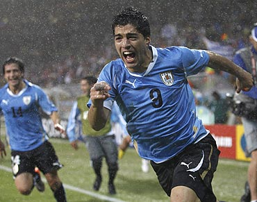 Luis Suarez celebrates after scoring the winning goal
