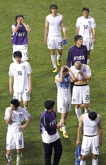 South Korean players after losing to Uruguay