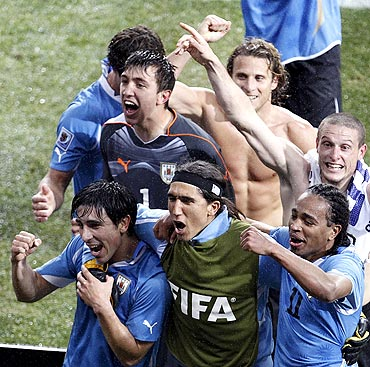Uruguayan reacts after the win