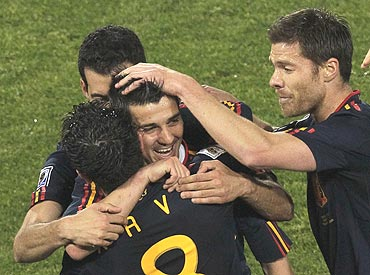 Spain's David Villa (centre) celebrates with teammates after scoring against Chile